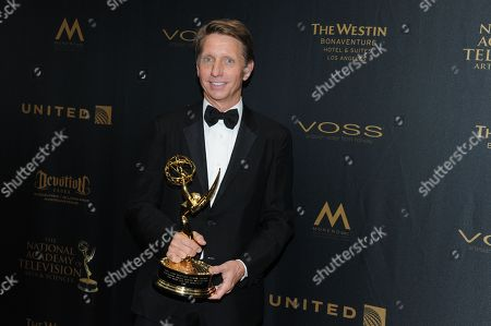 Bradley Bell poses in the pressroom with the award for outstanding writing in a drama series for The Bold and the Beautiful at the 43rd annual Daytime Emmy Awards at the Westin Bonaventure Hotel, in Los Angeles
