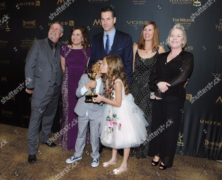 "Frank Valentini, center, and the cast and crew of ""General Hospital"" pose in the pressroom with the award for outstanding drama series for General Hospital at the 43rd annual Daytime Emmy Awards at the Westin Bonaventure Hotel, in Los Angeles"