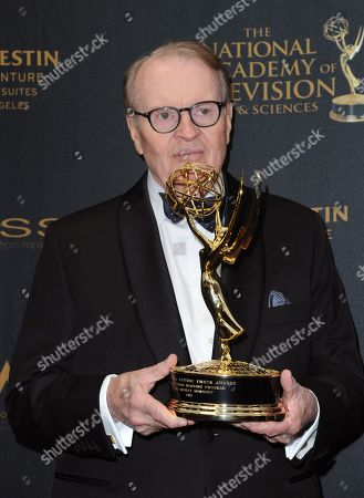Stock Photo of Charles Osgood poses in the pressroom with the award for outstanding morning program for CBS Sunday Morning at the 43rd annual Daytime Emmy Awards at the Westin Bonaventure Hotel, in Los Angeles