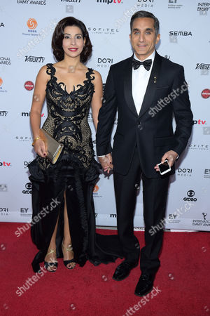 Stock Picture of Bassem Youssef, right, and Hala Diab attend the 43rd International Emmy Awards at the New York Hilton Hotel, in New York