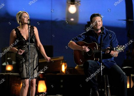 Gwen Sebastian, left, and Blake Shelton perform on stage at the 49th annual Academy of Country Music Awards at the MGM Grand Garden Arena, in Las Vegas