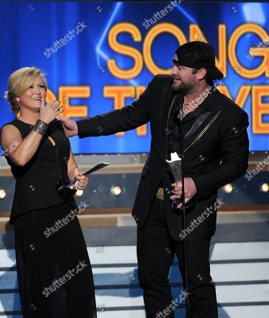 Lee Brice, right, and songwriter Connie Harrington accept the award for song of the year at the 49th annual Academy of Country Music Awards at the MGM Grand Garden Arena, in Las Vegas