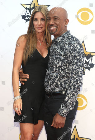 Tara Fowler, left, and Montel Williams arrive at the 50th annual Academy of Country Music Awards at AT&T Stadium, in Arlington, Texas