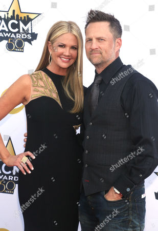 Nancy O'Dell, left, and Keith Zubulevich arrive at the 50th annual Academy of Country Music Awards at AT&T Stadium, in Arlington, Texas