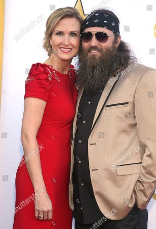 Korie Robertson, left, and Willie Robertson arrive at the 50th annual Academy of Country Music Awards at AT&T Stadium, in Arlington, Texas