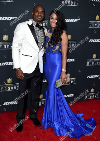 Adrian Peterson of the Minnesota Vikings, left, and Ashley Brown arrive at the 5th annual NFL Honors at the Bill Graham Civic Auditorium, in San Francisco