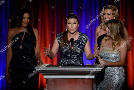 The Good News Girls, from left, Christine Devine, of KTTV/KCOP, Ana Garcia, of The Good News Foundation, Wendy Burch, of KTLA5, and Dorothy Lucey, of The Good News Foundation, speak on stage at the 65th Los Angeles Area Emmy Awards at the Leonard H. Goldenson Theatre, in Los Angeles