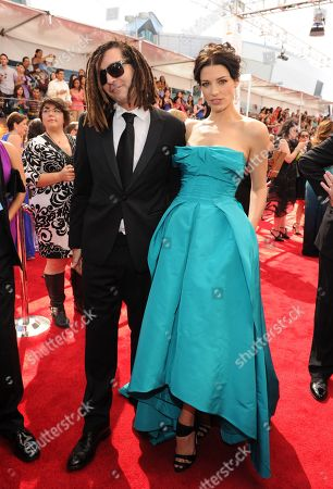 From left, John Kastner and Jessica Pare arrive at the 65th Primetime Emmy Awards at Nokia Theatre, in Los Angeles