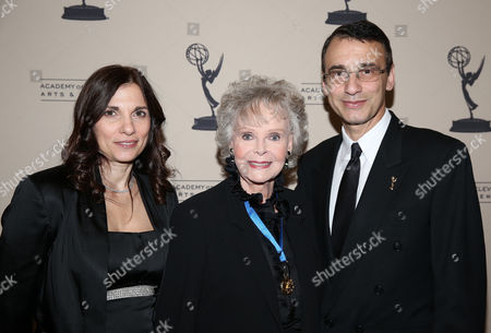 Stock Photo of From left, Gina Morrone, June Lockhart, and Academy Committee member Frank Morrone are seen at the 65th Primetime Emmy Engineering Awards,, at Loews Hollywood Hotel, in Hollywood, Calif