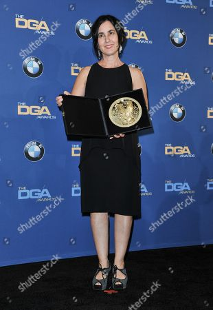 Amy Schatz poses in the press room of the the 66th Annual DGA Awards Dinner at the Hyatt Regency Century Plaza Hotel, in Los Angeles, Calif