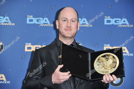 Stock Image of Martin de Thurah poses in the press room of the the 66th Annual DGA Awards Dinner at the Hyatt Regency Century Plaza Hotel, in Los Angeles, Calif