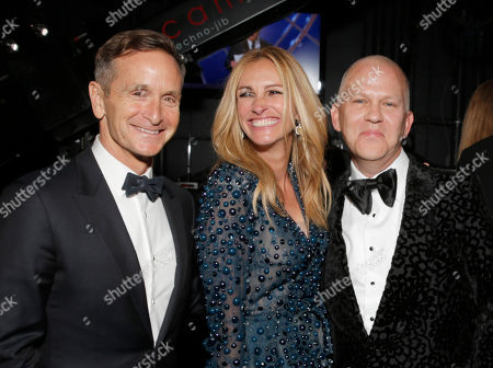 Stock Image of Dante Di Loreto, and from left, Julia Roberts and Ryan Murphy backstage at the 66th Primetime Emmy Awards at the Nokia Theatre L.A. Live, in Los Angeles