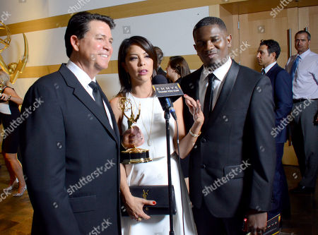 KTLA5's Glen Walker, from left, Cher Calvin and Marcus Smith, winners of the award for live coverage of an unscheduled news event, participate in an interview at the 67th Los Angeles Area Emmy Awards at the Skirball Cultural Center on