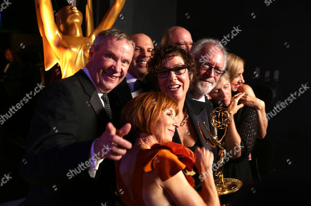 "Jane Anderson, winner of the outstanding limited series for ""Olive Kitteridge"", poses with fellow cast and crew members backstage at the 67th Primetime Emmy Awards, at the Microsoft Theater in Los Angeles"