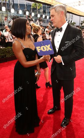 Taraji P. Henson, left, and Mark Moses arrive at the 67th Primetime Emmy Awards, at the Microsoft Theater in Los Angeles