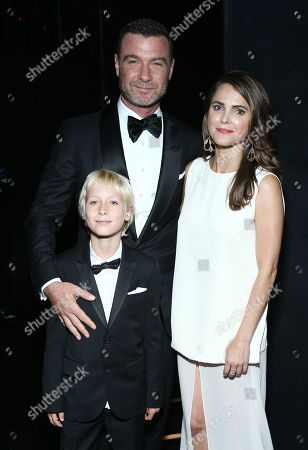 Keri Russell, from right, Liev Schreiber, and Alexander Pete Schreiber pose backstage at the 68th Primetime Emmy Awards, at the Microsoft Theater in Los Angeles