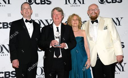 Stock Photo of Andre Bishop, second left, and crew pose with the award for the award for best revival of a musical for The King and I in the press room at the 69th annual Tony Awards at Radio City Music Hall, in New York