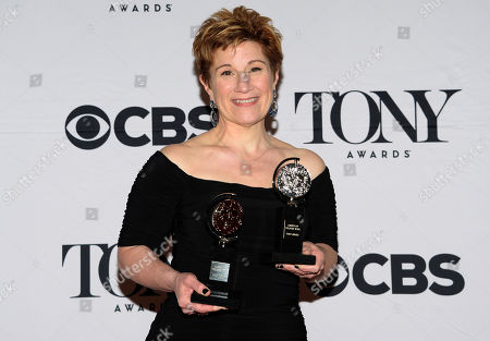 Stock Picture of Lisa Kron poses with the award for best book for Fun Home in the press room at the 69th annual Tony Awards at Radio City Music Hall, in New York