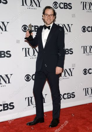 Sam Gold poses in the press room with the award for best direction of a musical for Fun Home at the 69th annual Tony Awards at Radio City Music Hall, in New York
