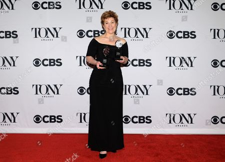 Lisa Kron poses with the award for best book for â?œFun Homeâ?? in the press room at the 69th annual Tony Awards at Radio City Music Hall, in New York