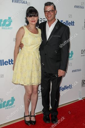 Pauley Perrette and Thomas Arklie attend the 6th Annual Thirst Gala at The Beverly Hilton Hotel on in Beverly Hills, Calif