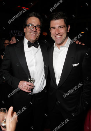 Stock Picture of Michael Spiller, left, and Max Greenfield attend the FOX after party for the 71st Annual Golden Globes award show on in Beverly Hills, Calif