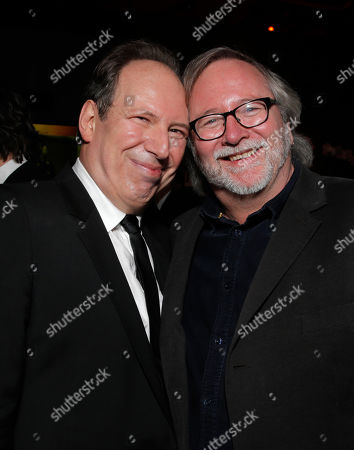 Hans Zimmer, left, and Sean Bobbitt attend the FOX after party for the 71st Annual Golden Globes award show on in Beverly Hills, Calif
