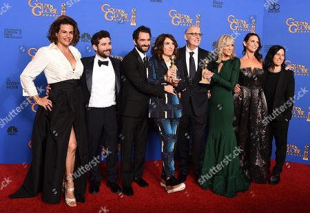 Alexandra Billing, from left, Joe Lewis, Jay Duplass, Jill Soloway, Jeffrey Tambor, Judith Light, Amy Landecker, and Andrea Sperling pose in the press room with the award for best actor in a television series - musical or comedy for â?oeTransparentâ?? at the 72nd annual Golden Globe Awards at the Beverly Hilton Hotel, in Beverly Hills, Calif