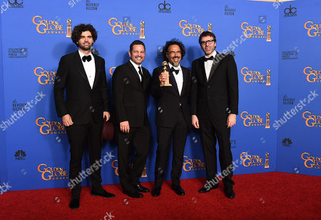 Armando Bo, from left, Alexander Dinelaris Jr., Alejandro Gonzalez Inarritu, and Nicolas Giacobone pose in the press room with the award for best screenplay for â?oeBirdmanâ?? at the 72nd annual Golden Globe Awards at the Beverly Hilton Hotel, in Beverly Hills, Calif
