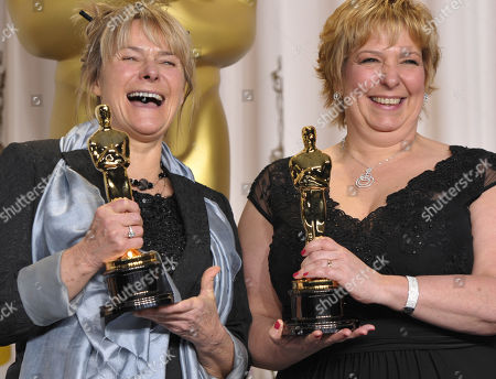"SCIENCES FOR USE UPON CONCLUSION OF THE ACADEMY AWARDS TELECAST ** Julie Dartnell, left, and Lisa Westcott pose with their award for best makeup and hairstyling for ""Les Miserables"" during at the Oscars at the Dolby Theatre, in Los Angeles"