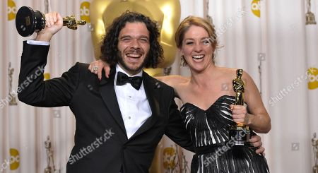 """Stock Picture of Sean Fine and Andrea Nix Fine pose with their award for best documentary short subject for """"Inocente"""" during the Oscars at the Dolby Theatre, in Los Angeles"""