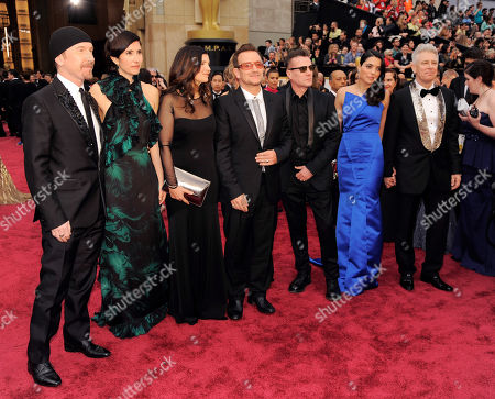 Stock Picture of Dave Evens, from left, Morleigh Steinberg, Ali Hewson, Bono, Mariana Teixeira De Carvalho and Adam Clayton arrive at the Oscars, at the Dolby Theatre in Los Angeles