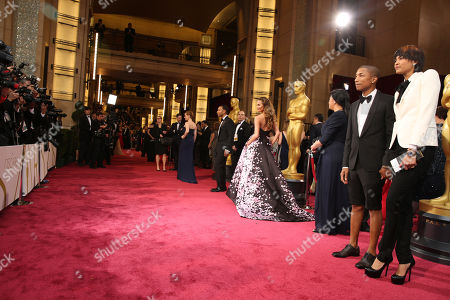 From right, Helen Lasichanh, Pharell Williams, Christine Teigen, and John Legend arrive at the Oscars, at the Dolby Theatre in Los Angeles