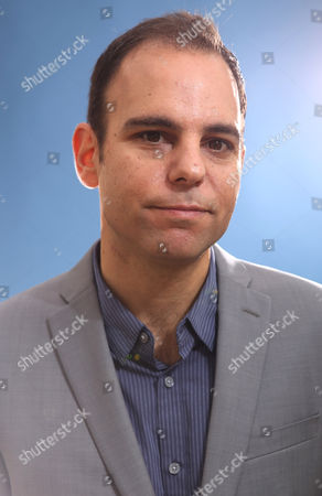 Josh Cohen poses for a portrait at the 86th Oscars Nominees Luncheon, on Monday, Feb., 9, 2014 in Beverly Hills, Calif