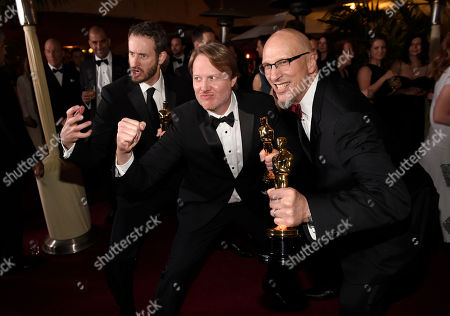 Roy Conli, from left, Don Hall, and Chris Williams attend the Governors Ball after the Oscars, in Los Angeles