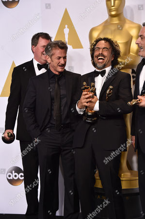 "Stock Photo of James W. Skotchdopole, and from left, Sean Penn, Alejandro Gonzalez Inarritu and John Lesher pose in the press room with the awards for best original screenplay, best director and best picture for Birdman"" at the Oscars, at the Dolby Theatre in Los Angeles"