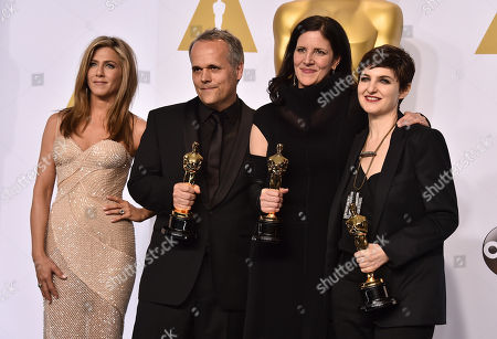 Stock Picture of Jennifer Aniston, and from left, Dirk Wilutzky, Laura Poitras and Mathilde Bonnefoy pose in the press room with the award for best documentary feature for Citizenfour at the Oscars, at the Dolby Theatre in Los Angeles