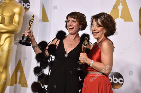 Stock Picture of Dana Perry, left, and Ellen Goosenberg Kent pose in the press room with the award for best short subject documentary for Crisis Hotline: Veterans Press 1 at the Oscars, at the Dolby Theatre in Los Angeles