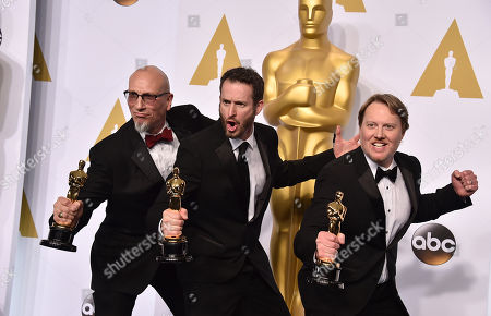 Roy Conli, and from left, Chris Williams and Don Hall pose in the press room with the award for best animated feature film for their work on Big Hero 6 at the Oscars, at the Dolby Theatre in Los Angeles