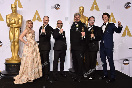 Chloe Grace Moretz, and from left, Paul Franklin, Andrew Lockley, Ian Hunter, Scott Fisher and Ansel Elgort pose in the press room with the award for best visual effects for Interstellar at the Oscars, at the Dolby Theatre in Los Angeles