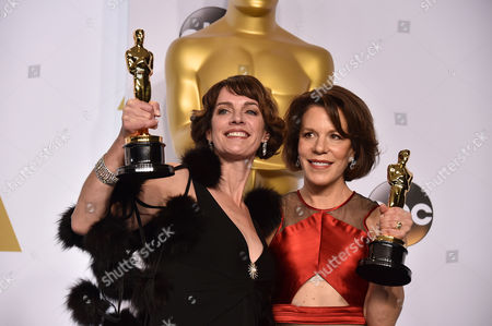 Dana Perry, left, and Ellen Goosenberg Kent pose in the press room with the award for best short subject documentary for Crisis Hotline: Veterans Press 1 at the Oscars, at the Dolby Theatre in Los Angeles