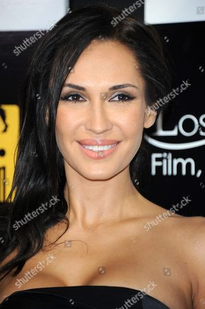 Stock Picture of Eugenia Chernyshova arrives at the 8th Annual Los Angeles, Italia Film, Fashion and Art Festival where Al Pacino is being honored with the Jack Valenti L.A. Italia Legend Award at the TCL Chinese Theatre on Sunday, Feb. 17,2013 in Los Angeles