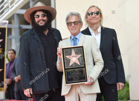From left, Don Was, Al Schmitt and Joe Walsh pose during a ceremony honoring Al Schmitt with a star on the Hollywood Walk of Fame on in Los Angeles