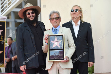 Don Was, from left, Al Schmitt and Joe Walsh pose during a ceremony honoring Schmitt with a star on the Hollywood Walk of Fame, in Los Angeles