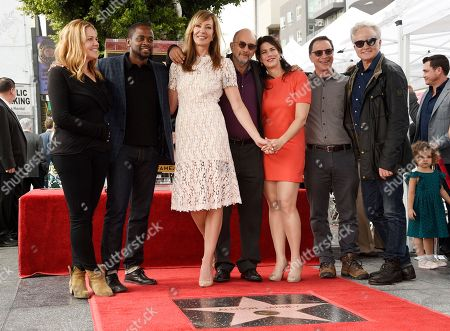 """Allison Janney, third from left, poses with fellow cast members of the television series """"The West Wing,"""" from left, Mary McCormack, Dule Hill, Richard Schiff, Melissa Fitzgerald, Joshua Malina and Bradley Whitford following a ceremony to award Janney a star on the Hollywood Walk of Fame, in Los Angeles"""