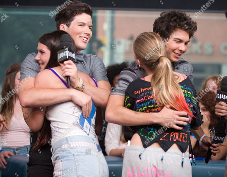 Stock Picture of Singer Zachary Porter and musician Cameron Quiseng of the band Allstar Weekend hug fans during an interview at New.Music.Live. at the MuchMusic HQ, in Toronto