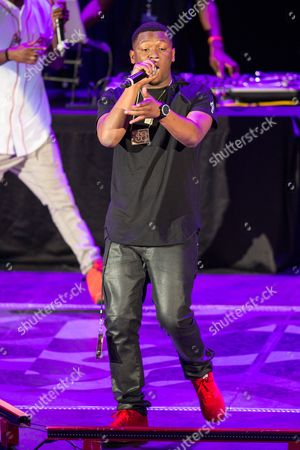 Stock Image of Hit Boy (AKA Chauncey Hollis) performs as a part of the America's Most Wanted Tour at the Verizon Wireless Amphitheater on in Irvine, Calif