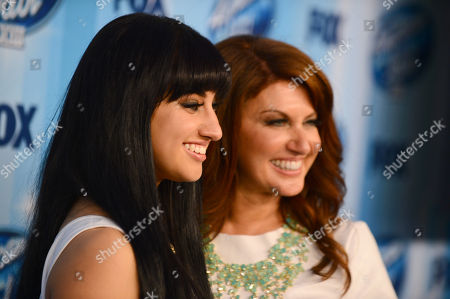 Jena Irene, left, and Julie Asciutto pose in the press room at the American Idol XIII finale at the Nokia Theatre at L.A. Live, in Los Angeles