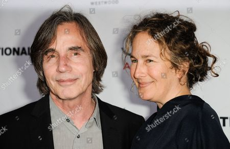 """Jackson Browne, left, and Dianna Cohen arrive at the annual """"Backstage At The Geffen"""" event at the Geffen Playhouse on in Los Angeles"""