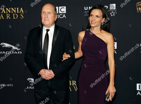 Robert Duvall, left, and Luciana Pedraza arrive at the BAFTA Los Angeles Britannia Awards at the Beverly Hilton Hotel, in Beverly Hills, Calif